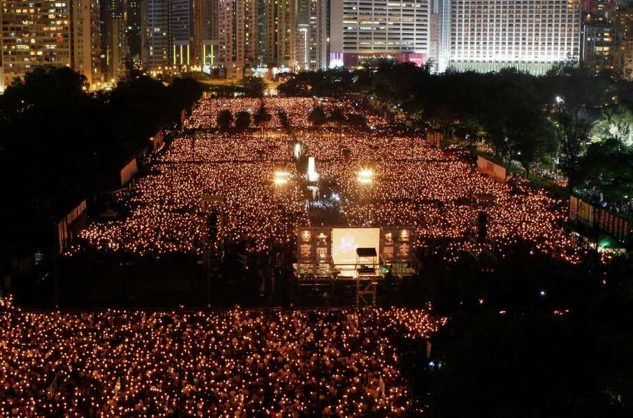 Tens of thousands of people attend a candlelight vigil at Hong Kong's Victoria Park Monday, June 4, 2012 to mark the 23rd anniversary of the Chinese military crackdown on the pro-democracy movement in Beijing. (AP Photo/Kin Cheung) Photo: Kin Cheung, Associated Press / AP