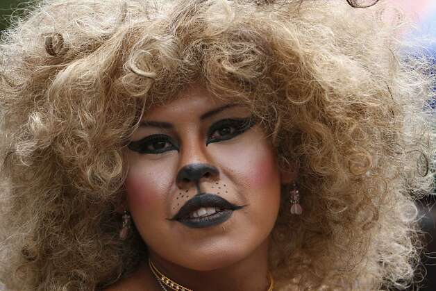 ... costume pauses for a portrait during a gay pride parade in Mexico City, ...
