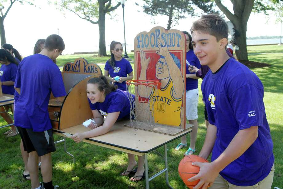 Volunteer Joe Nelson helps out with the carnival games at Norwalk Mentor Program End of the Year celebration at Calf Pasture Beach in Norwalk, Conn. on Friday June 1, 2012. Photo: Dru Nadler / Stamford Advocate Freelance
