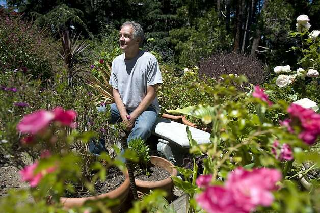 "John Lowen sits for a portrait in his garden at 235 Greenwich St.  The Garden Conservancy, a national nonprofit group, held its annual ""open days"" event at several private gardens on Telegraph Hill Sunday June 3rd, 2012. Photo: Michael Short, Special To The Chronicle"