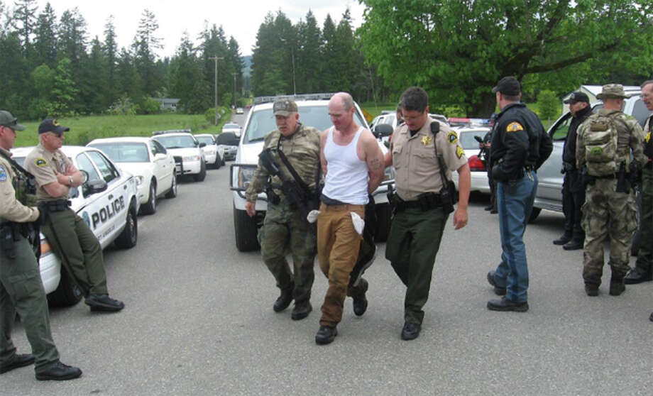 Clallam County deputies and other law enforcement officers take Patrick B. Drum, 34, into jail on Sunday, June 3, 2012. Drum is accused of killing two rapists he knew personally. Photo: Clallam County Sheriff's Office