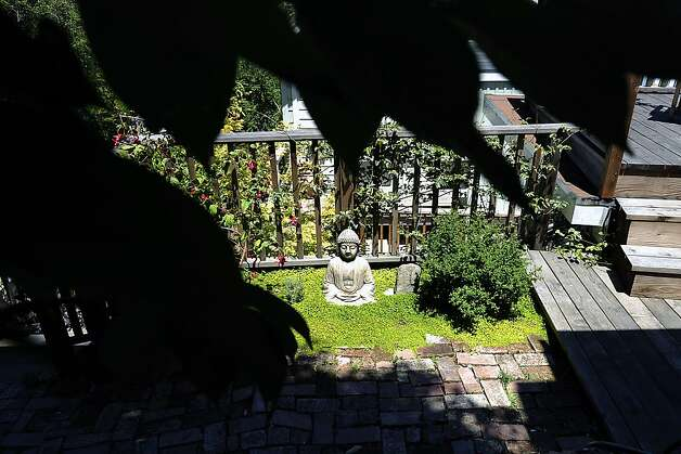 "A budha statue sits in a green space above Denise St. Onge's garden.  The Garden Conservancy, a national nonprofit group, held its annual ""open days"" event at several private gardens on Telegraph Hill Sunday June 3rd, 2012. Photo: Michael Short, Special To The Chronicle"