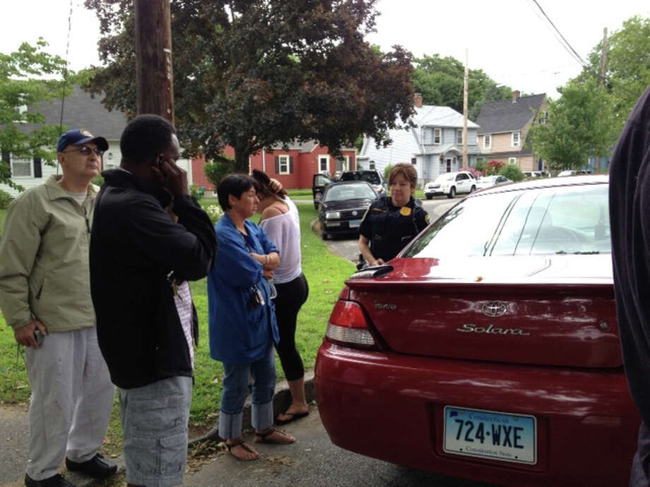 Police investigate a stabbing on Monday, June 4, 2012 on Holmes Street in Stratford, Conn. Photo: Frank Juliano