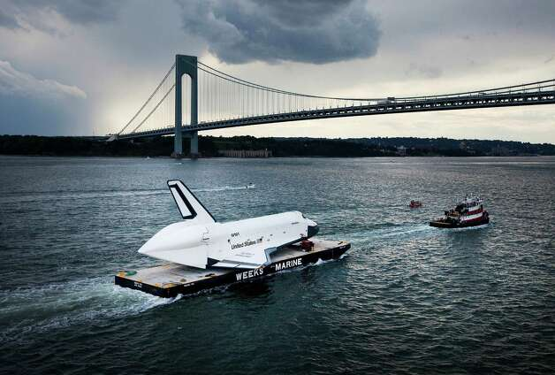 The atmospheric test space shuttle Enterprise is carried by barge underneath the Verrazano-Narrows Bridge on June 3, 2012 in New York City.  Enterprise is on its way to the Intrepid Sea, Air and Space Museum, where it will put on permanent display. Photo: Michael Nagle, Getty Images / 2012 Getty Images