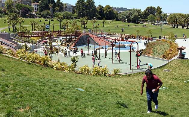 "San Francisco new children's playground inside Dolores Park, recently celebrated it's grand opening. Not long after that, vandals damaged the cool xylophone in the music area. Six or so of the 14 keys have gone missing, making it less fun to play. Vandals also etched the tops of the drums. Not far from there, by one of the ""boats, "" a graffiti ""artist"" stenciled fish on the bouncy blue ground. Those are just some of the incidents of vandalism in the city's public parks. Wednesday May 30, 2012. Photo: Lance Iversen, The Chronicle"
