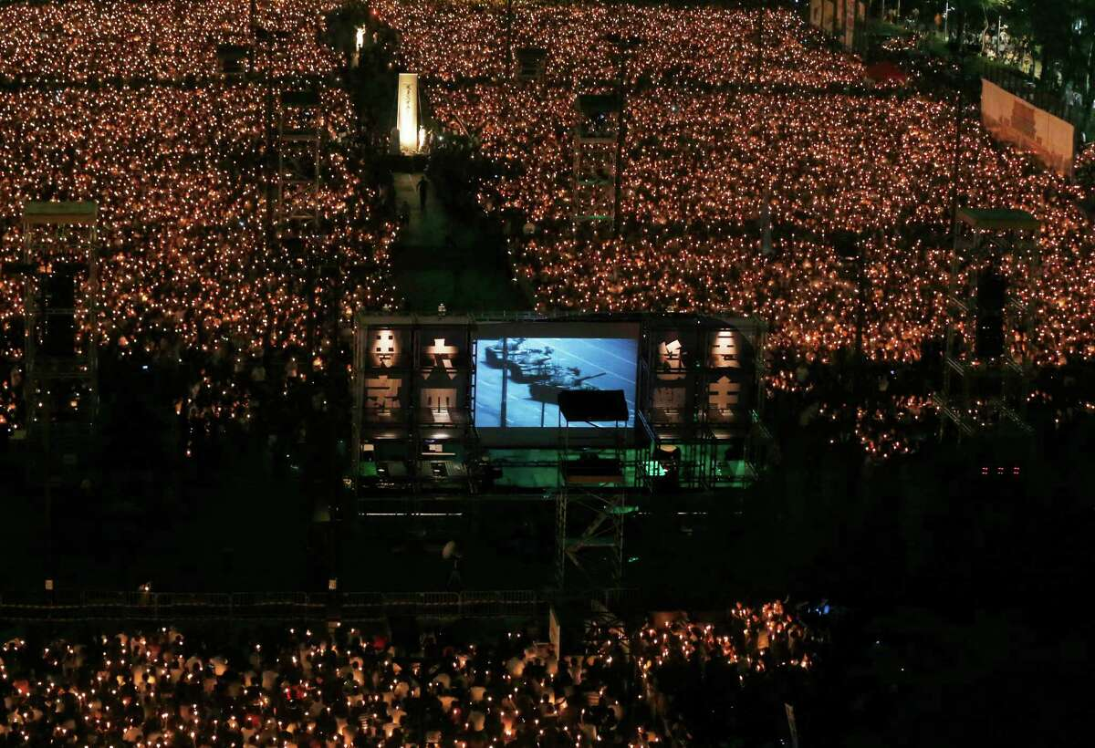 Tens of thousands of people attend a candlelight vigil at Hong Kong's Victoria Park Monday to mark the 23rd anniversary of the Chinese military crackdown on the pro-democracy movement in Beijing.