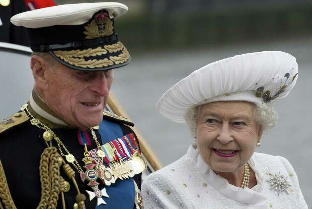 Britain's Queen  Elizabeth and Prince Philip leave from Chelsea Harbour in London on a launch on the first part of their journey in the Diamond Jubilee River Pageant Sunday June 3, 2012 . More than 1,000 boats will sail down the River Thames on Sunday in a flotilla tribute to Queen Elizabeth II's 60 years on the throne that organizers are calling the biggest pageant on the river for 350 years. Photo: EDDIE MULHOLLAND, Ap / AP2012