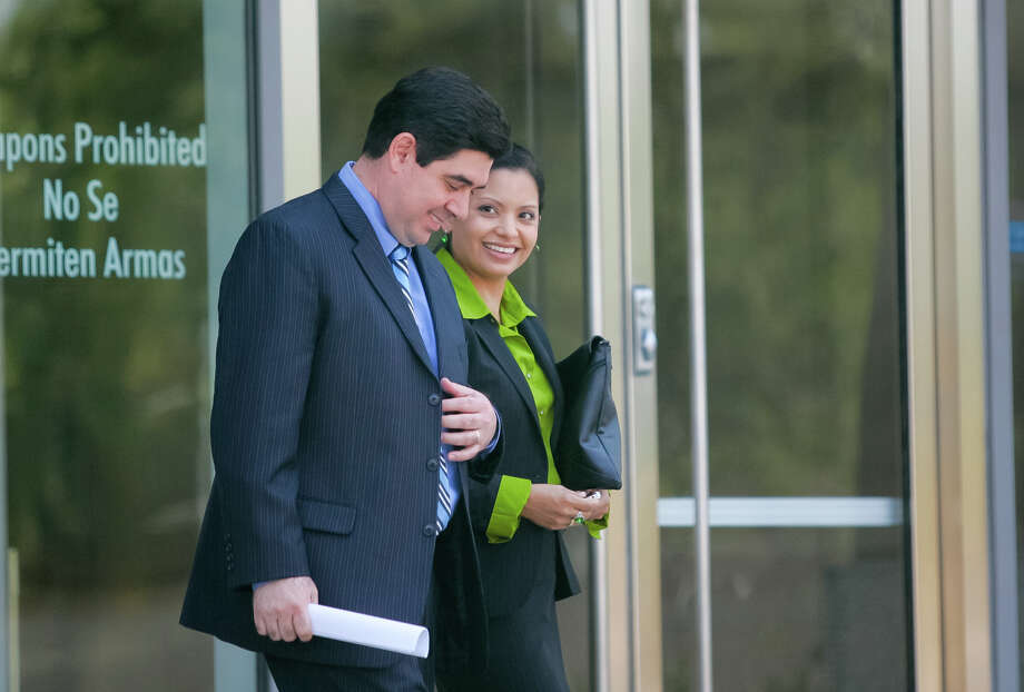 Armando Villalobos and his wife Yolanda walk out of the Federal Courthouse in Brownsville lst month. The Cameron County DA should resign or take a leave of absence until the corruption charges against him are resolved. Photo: Yvette Vela, Brownsville Herald