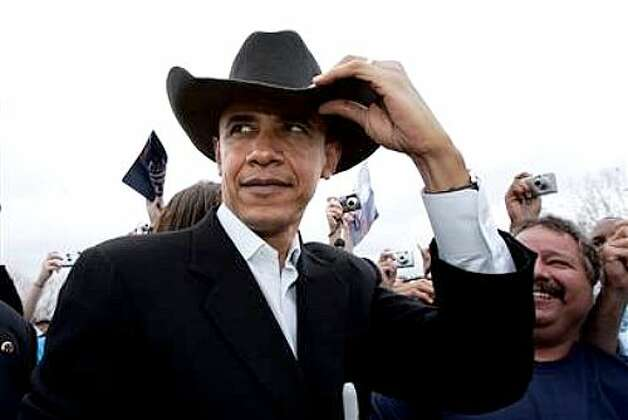 Barack Obama dons a cowboy hat. (AP photo)