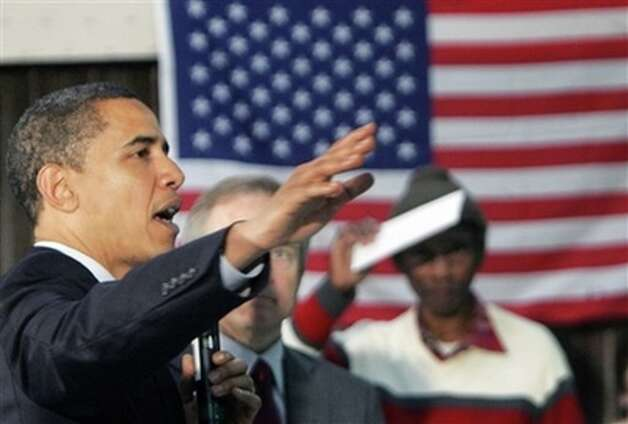Democratic presidential hopeful Sen. Barack Obama, D-Ill., speaks with veterans during a campaign event at the American Legion Post 490 Friday, Feb. 29, 2008, in Houston, Texas. (AP Photo/Rick Bowmer) Photo: Rick Bowmer, AP / AP