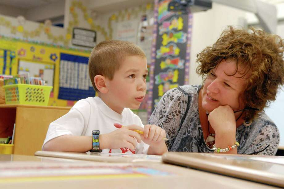 Literacy coach Sarah Santasiero works with first grade student Rocco Lucia at Stark Elementary School in Stamford, Conn.  on Monday June 4, 2012 . Photo: Dru Nadler / Stamford Advocate Freelance