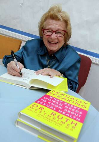 "Dr. Ruth Westheimer signs a copy of her book ""Sexually Speaking"" after a lecture in April. Photo: Associated Press / AP"