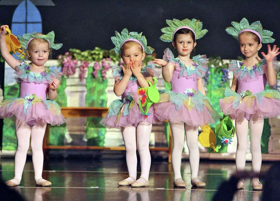 Flower Fairies and Darien residents, from left, Cecilia Costa, Ellie Briggs, Julia Washburn and Sheridan Whitacre from the Darien School of Dance at the YWCA Darien/Norwalk dance during the Second Annual Spring Showcase in Darien Conn. Photo: Contributed Photo