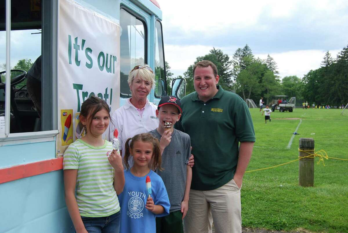 Kendall Beladino, Paxton Beladino, Bart Codd, Bank of New Canaan Director Judy Bentley and marketing associate Kevin Randall during the Bank of New Canaan's ice cream giveaway Saturday, June 2, in New Canaan Conn.
