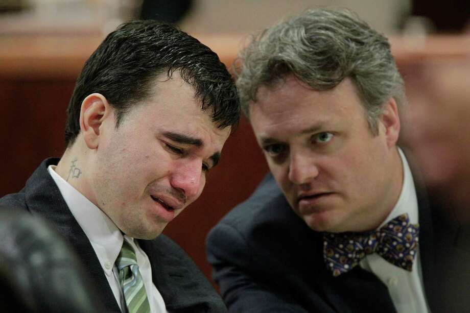 Johoan Rodriguez leans toward defense attorney Adam Brown while weeping during jury selection in the 183rd State District Court at the Harris County Criminal Justice Center on Monday, June 4, 2012, in Houston. Rodriguez is having a week-long punishment trial starting today after pleading guilty to intoxication manslaughter in the June 2011 death of Houston Police Officer Kevin Will, 38. Photo: Mayra Beltran, Houston Chronicle / Houston Chronicle