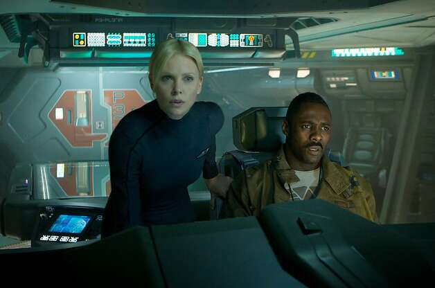 Charlize Theron and Idris Elba on the bridge of the ship Prometheus. (Kerry Brown/MCT) Photo: Handout, McClatchy-Tribune News Service