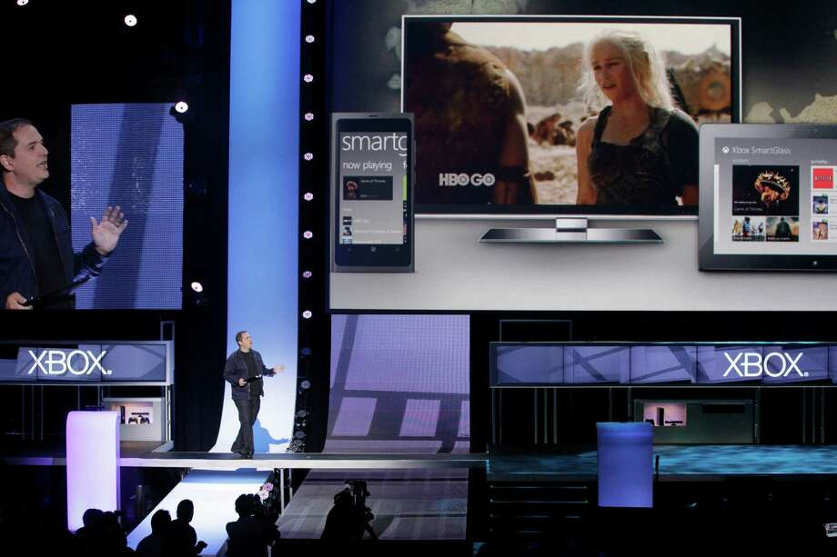 Microsoft Xbox LIVE Corporate Vice President Marc Whitten, left, presents Xbox SmartGlass technology at the Microsoft Xbox E3 2012 media briefing in Los Angeles on Monday, June 4, 2012. Photo: AP