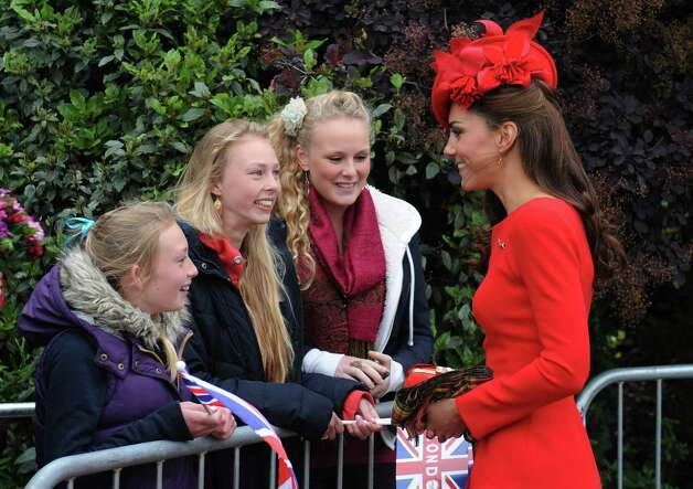 LONDON, ENGLAND - JUNE 03: Catherine, Duchess of Cambridge, meets well wishers before boarding  the Spirit of Chartwell for the Diamond Jubilee Pageant  to celebrate Queen Elizabeth's Diamond Jubilee on June 3, 2012 in London, England. For only the second time in its history the UK celebrates the Diamond Jubilee of a monarch. Her Majesty Queen Elizabeth II celebrates the 60th anniversary of her ascension to the throne. Thousands of well-wishers from around the world have flocked to London to witness the spectacle of the weekend's celebrations. The Queen along with all members of the royal family will participate in a River Pageant with a flotilla of a 1,000 boats accompanying them down The Thames. Photo: WPA Pool, Getty Images / 2012 Getty Images