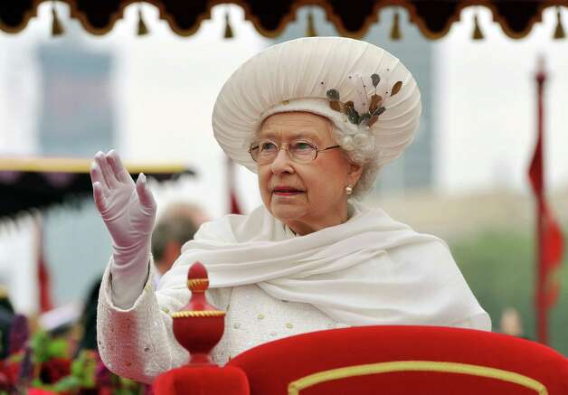 LONDON, ENGLAND - JUNE 03:  Queen Elizabeth II waves from the Spirit of Chartwell during the Diamond Jubilee Thames River Pageant on June 3, 2012 in London, England. For only the second time in its history the UK celebrates the Diamond Jubilee of a monarch. Her Majesty Queen Elizabeth II celebrates the 60th anniversary of her ascension to the throne. Thousands of well-wishers from around the world have flocked to London to witness the spectacle of the weekend's celebrations. The Queen along with all members of the royal family will participate in a River Pageant with a flotilla of a 1,000 boats accompanying them down The Thames, the star studded free concert at Buckingham Palace, and a carriage procession and a service of thanksgiving at St Paul's Cathedral. Photo: WPA Pool, Getty Images / 2012 Getty Images