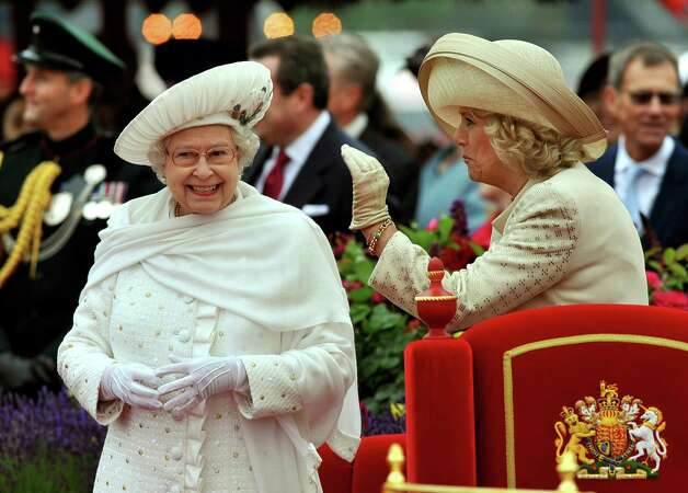 LONDON, ENGLAND - JUNE 03: Queen Elizabeth II and Camilla, Duchess of Cornwall onboard the Spirit of Chartwell during the Diamond Jubilee Pageant on the River Thames during the Diamond Jubilee Thames River Pageant on June 3, 2012 in London, England. For only the second time in its history the UK celebrates the Diamond Jubilee of a monarch. Her Majesty Queen Elizabeth II celebrates the 60th anniversary of her ascension to the throne. Thousands of well-wishers from around the world have flocked to London to witness the spectacle of the weekend's celebrations. The Queen along with all members of the royal family will participate in a River Pageant with a flotilla of a 1,000 boats accompanying them down The Thames, the star studded free concert at Buckingham Palace, and a carriage procession and a service of thanksgiving at St Paul's Cathedral. Photo: WPA Pool, Getty Images / 2012 Getty Images