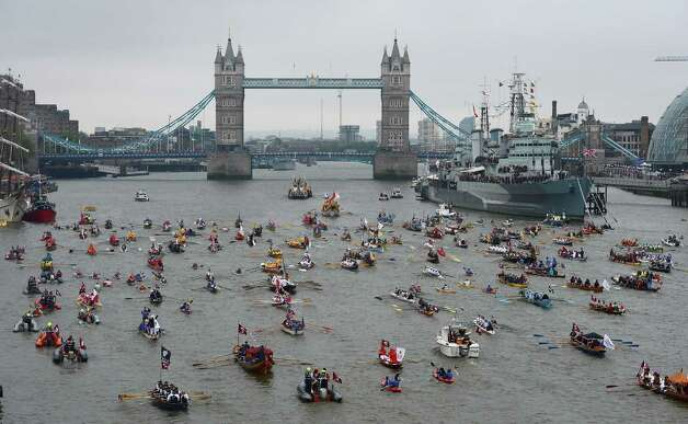 LONDON, ENGLAND - JUNE 03:  The flotilla of 1000 boats sails towards Tower Bridge during the Diamond Jubilee Thames River Pageant  on June 3, 2012 in London, England. For only the second time in its history the UK celebrates the Diamond Jubilee of a monarch. Her Majesty Queen Elizabeth II celebrates the 60th anniversary of her ascension to the throne. Thousands of well-wishers from around the world have flocked to London to witness the spectacle of the weekend's celebrations. The Queen along with all members of the royal family will participate in a River Pageant with a flotilla of a 1,000 boats accompanying them down the Thames, the star studded free concert at Buckingham Palace, and a carriage procession and a service of thanksgiving at St Paul's Cathedral. Photo: Gareth Copley, Getty Images / 2012 Getty Images