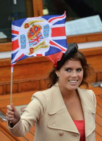 LONDON, ENGLAND - JUNE 03:  Princess Eugenie waves a flag during the Diamond Jubilee Thames River Pageant on June 3, 2012 in London, England. For only the second time in its history the UK celebrates the Diamond Jubilee of a monarch. Her Majesty Queen Elizabeth II celebrates the 60th anniversary of her ascension to the throne. Thousands of well-wishers from around the world have flocked to London to witness the spectacle of the weekend's celebrations. The Queen along with all members of the royal family will participate in a River Pageant with a flotilla of a 1,000 boats accompanying them down the Thames. Photo: Jeff J Mitchell, Getty Images / 2012 Getty Images