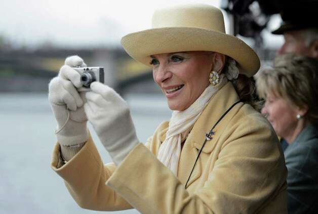 LONDON, ENGLAND - JUNE 03:  Princess Michael of Kent takes pictures of the boats from the deck of 'Havengore' during the Thames Diamond Jubilee Pageant on the River Thames on June 3, 2012 in London, England. For only the second time in its history the UK celebrates the Diamond Jubilee of a monarch. Her Majesty Queen Elizabeth II celebrates the 60th anniversary of her ascension to the throne. Thousands of well-wishers from around the world have flocked to London to witness the spectacle of the weekend's celebrations. The Queen along with all members of the royal family will participate in a River Pageant with a flotilla of a 1,000 boats accompanying them down the Thames. Photo: Pool, Getty Images / 2012 Getty Images