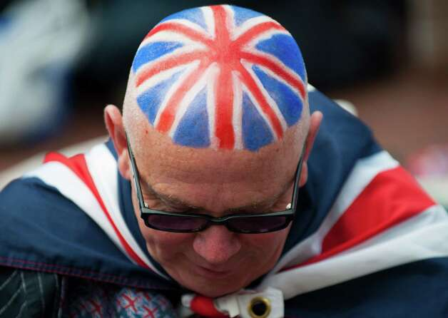 LONDON - MAY 04:  A man shows off his patriotic head dye ahead of the Diamond Jubilee, Buckingham Palace Concert May 04, 2012 in London, England. For only the second time in it's history, the UK celebrates the Diamond Jubilee of a monarch. Her Majesty Queen Elizabeth II celebrates the 60th anniversary of her ascension to the throne. Photo: WPA Pool, Getty Images / 2012 Getty Images