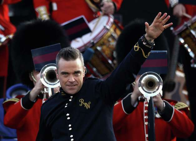 LONDON, ENGLAND - JUNE 04:  Singer Robbie Williams performs on stage during the Diamond Jubilee concert at Buckingham Palace on June 4, 2012 in London, England. For only the second time in its history the UK celebrates the Diamond Jubilee of a monarch. Her Majesty Queen Elizabeth II celebrates the 60th anniversary of her ascension to the throne. Thousands of well-wishers from around the world have flocked to London to witness the spectacle of the weekend's celebrations. Photo: Dan Kitwood, Getty Images / 2012 Getty Images