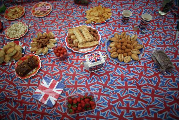LONDON, ENGLAND - JUNE 04:  An afternoon tea party laid out by revellers on the The Mall as thousands gather for The Diamond Jubilee Concert on June 4, 2012 in London, England. For only the second time in it's history, the UK celebrates the Diamond Jubilee of a monarch. Her Majesty Queen Elizabeth II celebrates the 60th anniversary of her ascension to the throne. Photo: Christopher Furlong, Getty Images / 2012 Getty Images