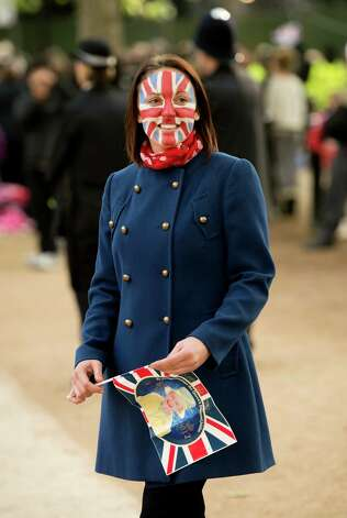 LONDON, ENGLAND - JUNE 04:  A woman smiles wearing face paint of the Union Jack flag on The Mall during the Diamond Jubilee Buckingham Palace Concert on June 4, 2012 in London, England. For only the second time in its history, the UK celebrates the Diamond Jubilee of a monarch. Her Majesty Queen Elizabeth II celebrates the 60th anniversary of her ascension to the throne. Photo: Ian Gavan, Getty Images / 2012 Getty Images