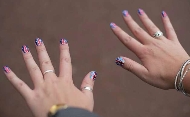LONDON, ENGLAND - JUNE 04:  A woman displays her Union Jack painted fingernails during the Diamond Jubilee Buckingham Palace Concert on June 4, 2012 in London, England. For only the second time in its history, the UK celebrates the Diamond Jubilee of a monarch. Her Majesty Queen Elizabeth II celebrates the 60th anniversary of her ascension to the throne. Photo: Ian Gavan, Getty Images / 2012 Getty Images