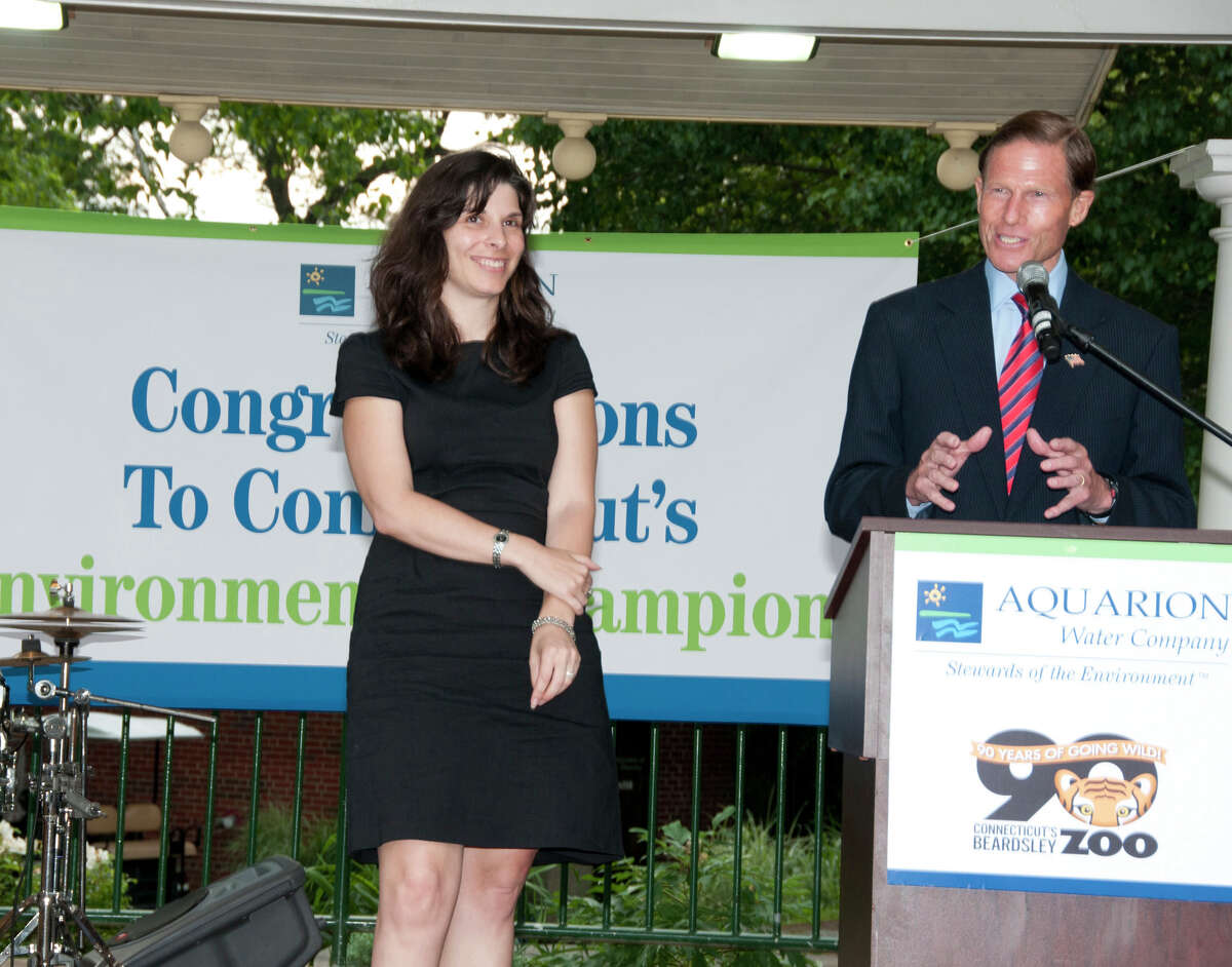 U.S. Sen. Richard Blumenthal presents the Aquarion Environmental Champion Award for Large Business to Zelia Kranich of Pitney Bowes, Shelton.
