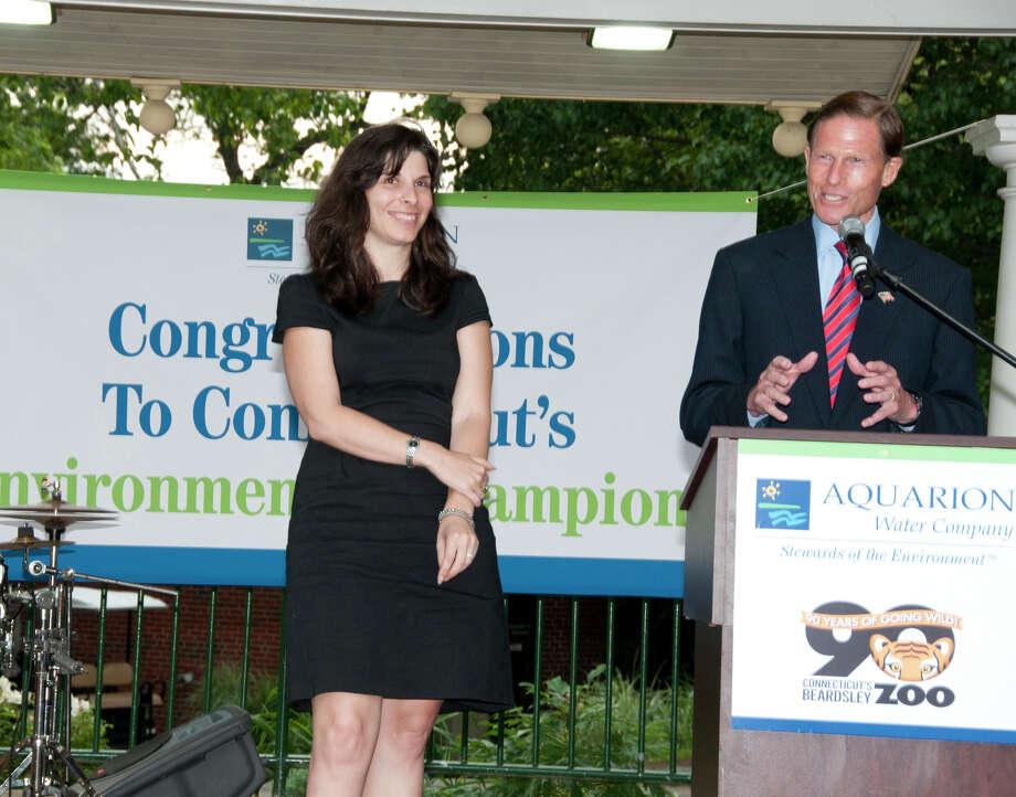 U.S. Sen. Richard Blumenthal presents the Aquarion Environmental Champion Award for Large Business to Zelia Kranich of Pitney Bowes, Shelton. Photo: Roger Salls / Connecticut Post