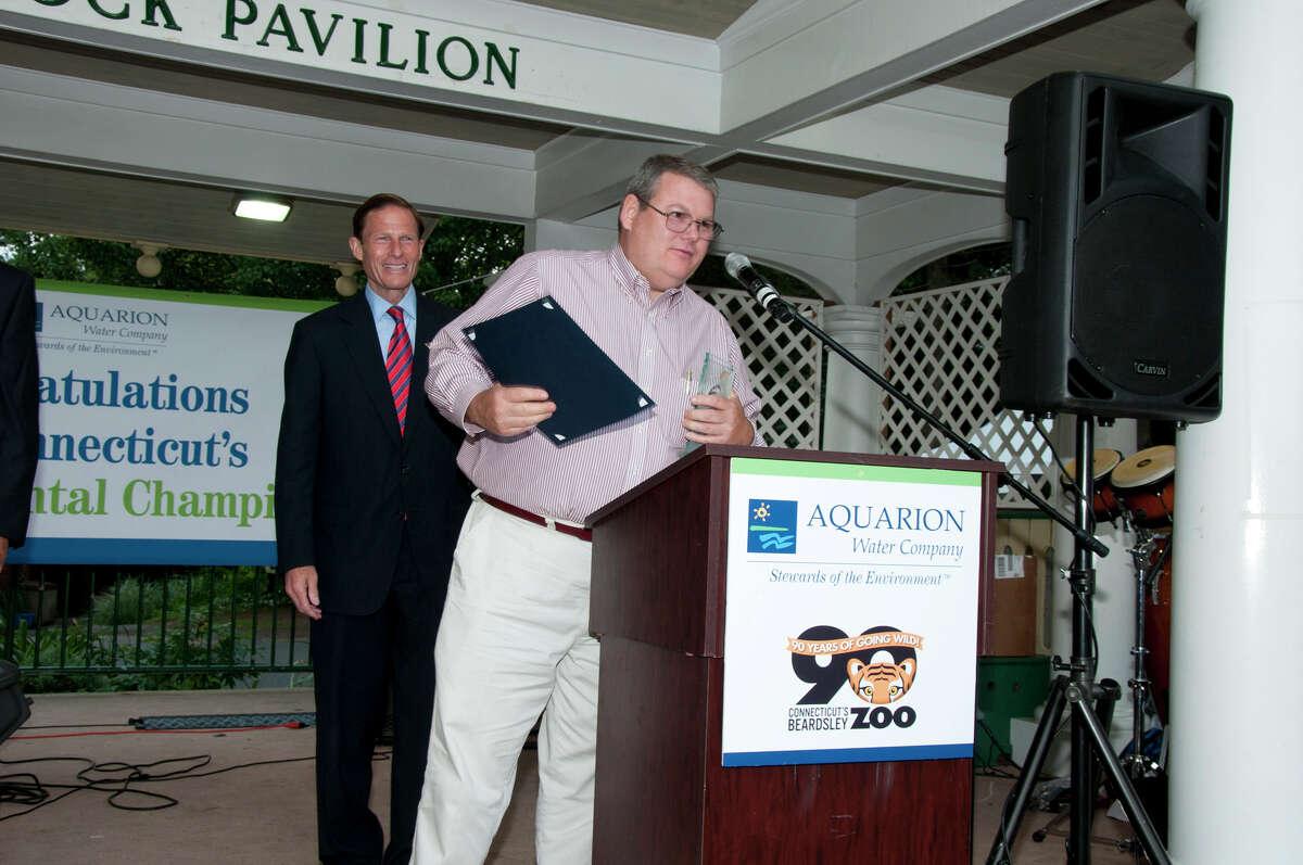 U.S. Sen. Richard Blumenthal presents the Aquarion Environmental Champion Award for Small Business to Jim Davenport of Harvest Moon Timber Frame, Morris.