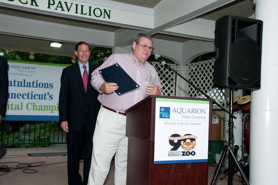 U.S. Sen. Richard Blumenthal presents the Aquarion Environmental Champion Award for Small Business to Jim Davenport of Harvest Moon Timber Frame, Morris. Photo: Roger Salls / Connecticut Post