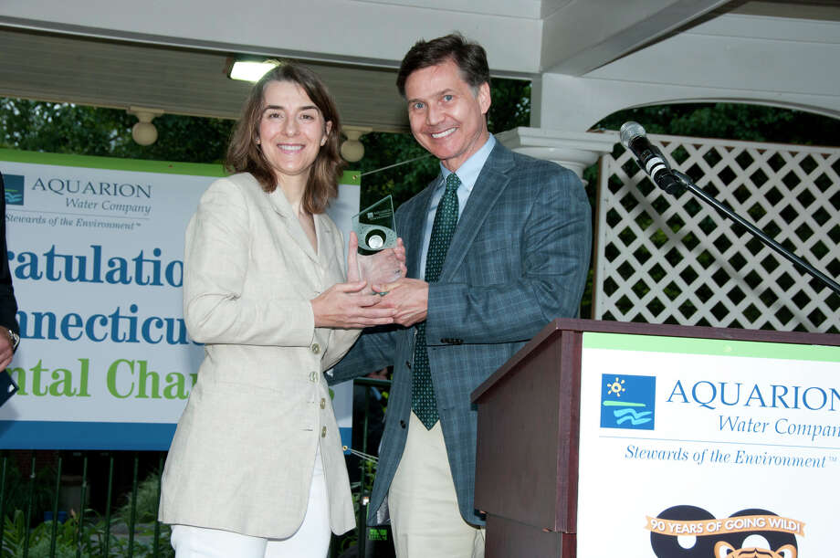CT Department of Energy and Environmental Protection Commissioner Daniel Esty presents the Aquarion Environmental Champion Award for Nonprofit to Dara Reid of Wildlife in Crisis, Weston. Photo: Roger Salls / Connecticut Post