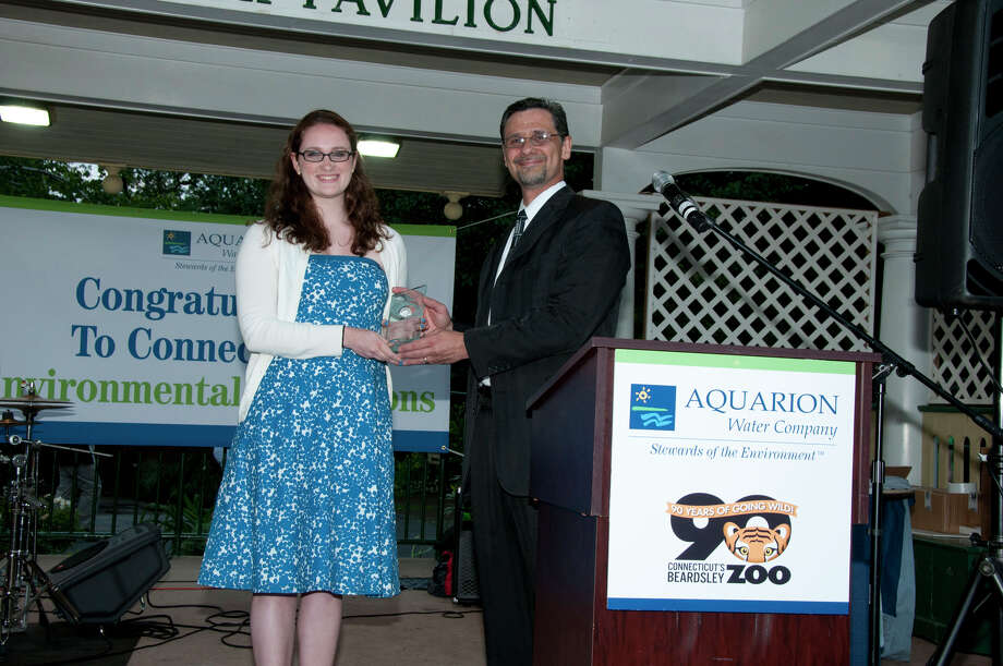 John DeAugustine, group publisher, Hearst Media Services, presents the Aquarion Environmental Champion Award for Youth to Elisabeth Smith from Stamford. Photo: Roger Salls / Connecticut Post