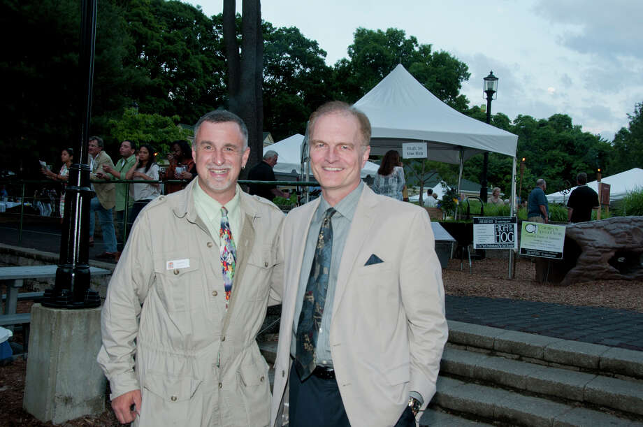 Greg Dancho, director of CT's Beardsley Zoo, with Chuck Firlotte, president and CEO of  Aquarion Water Co. during the Wild Wine, Beer, and Food Safari fundraiser on June 2 at Connecticut's Beardsley Zoo. Photo: Roger Salls / Connecticut Post