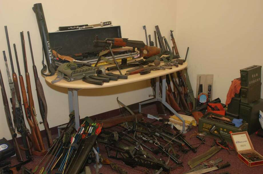 Bethlehem police said they seized this cache of weapons while executing a search warrant on the Selkirk home of James E. Domery early June 4, 2012. Police were at the home to invesitgate a report of domestic violence in which the suspect was allegedly threatening to kill the victim.Among the firearms sezied were a semi-automatic handgun, a machine gun, an assault weapon, a 20 gauge sawed off shotgun and a revolver that had their serial numbers removed and multiple large capacity ammunition feeding devices and magazines. (Photo: Courtesy Bethlehem Police Department)