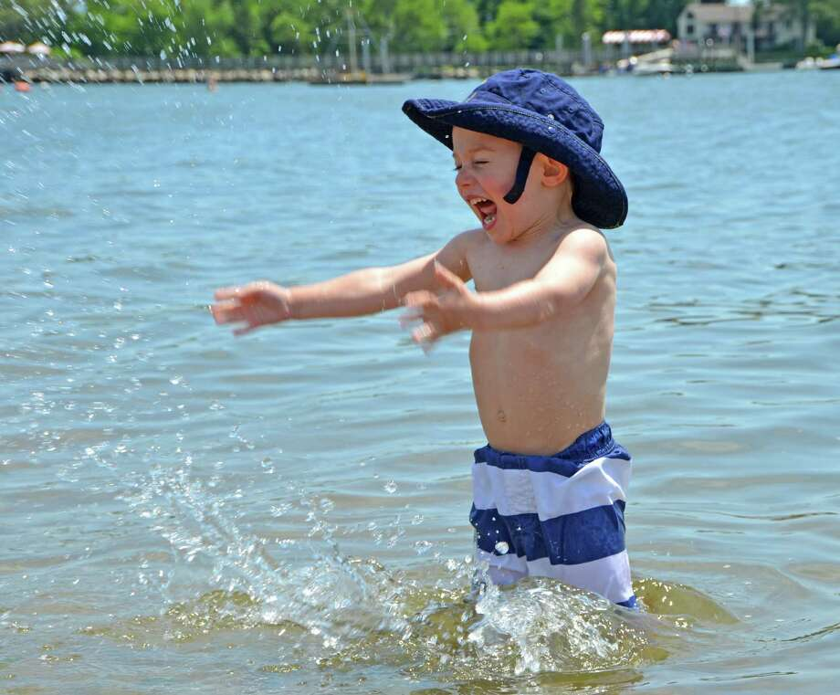 Three-year-old Liam Sullivan has a happy first splash at the Grand Opening of Weed Beach in Darien, Conn.  Sunday, June 3, 2012. Photo: Jeanna Petersen Shepard