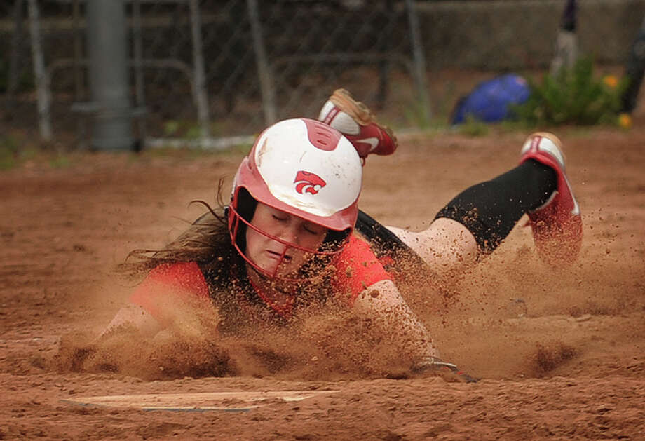 Masuk's Victoria Schiebe slides safely into home for the Panthers' only run in the seventh inning of their Class LL softball semifinal loss to Southington at DeLuca Field in Stratford on Monday, June 4, 2012. Photo: Brian A. Pounds / Connecticut Post