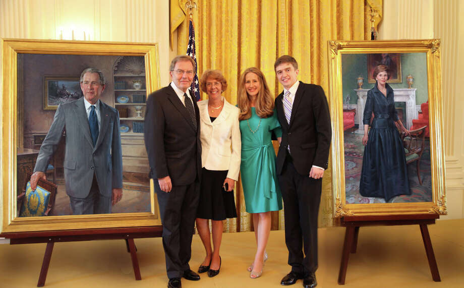 From left, John Howard Sanden, wife Elizabeth Sanden, daughter Pamela McMahon,  son Jonathan Sanden in the White House East Room, May 31, 2012. John Sanden of Ridgefield, painted the official portraits of President and Mrs. Bush for the White House. Photo: Contributed Photo
