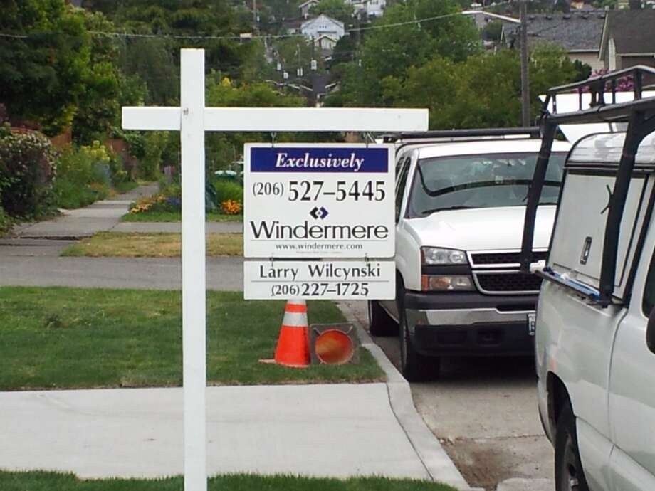 A Windermere sign hangs in front of a home under construction in Ballard on Monday, June 4, 2012 Photo: Aubrey Cohen/seattlepi.com