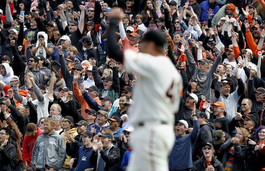 Jeremy Affeldt raised his fist as second baseman Ryan Theriot made a great play to end the game.  Thousands cheered. The San Francisco Giants beat the Chicago Cubs 3-2 at AT&T park Monday June 4, 2012 to sweep the series. Photo: Brant Ward, The Chronicle