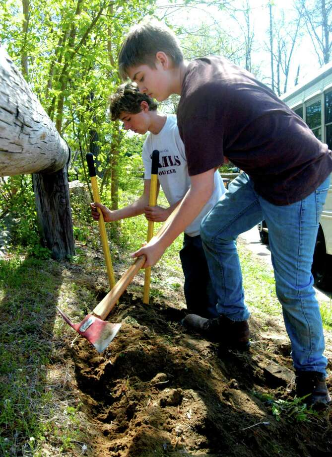 Kellen Ness, foreground, and Sam Thomas do their share on a landscaping project undertaken by the New Milford Youth Agency at The Maxx in New Milford. May 2012 Photo: Norm Cummings
