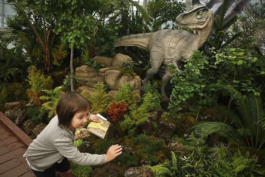 "Stella Fowler runs in a part of ""Plantosaurus Rex,"" designed to use vegetation so that children form a relationship with plant life. Photo: Russell Yip, The Chronicle"