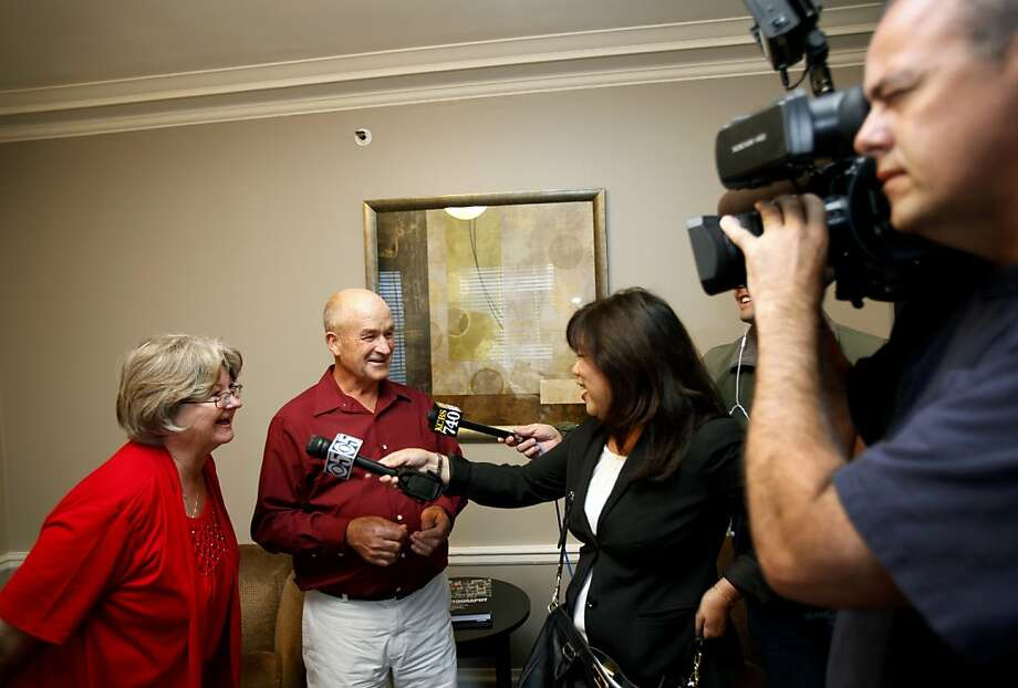 Larry and Barbara Richardson are interviewed by the press at their hotel room in San Francisco, Calif. Monday, June 4, 2012.  The Richardsons built a replica of the Golden Gate bridge on their property in Kansas and landed Monday night to visit the city and see the bridge up close. Photo: Sarah Rice, Special To The Chronicle