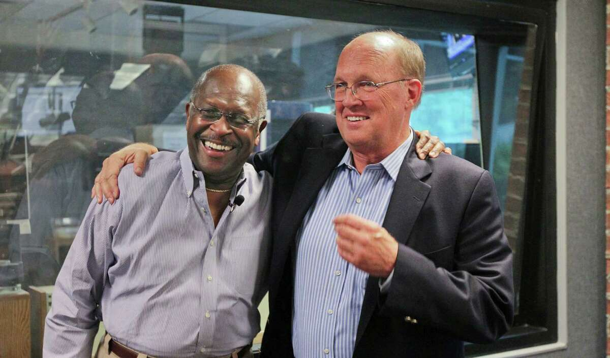Herman Cain congratulates Neal Boortz, right, on his retirement announcement after the pair went on the WSB radio together Monday in Atlanta.
