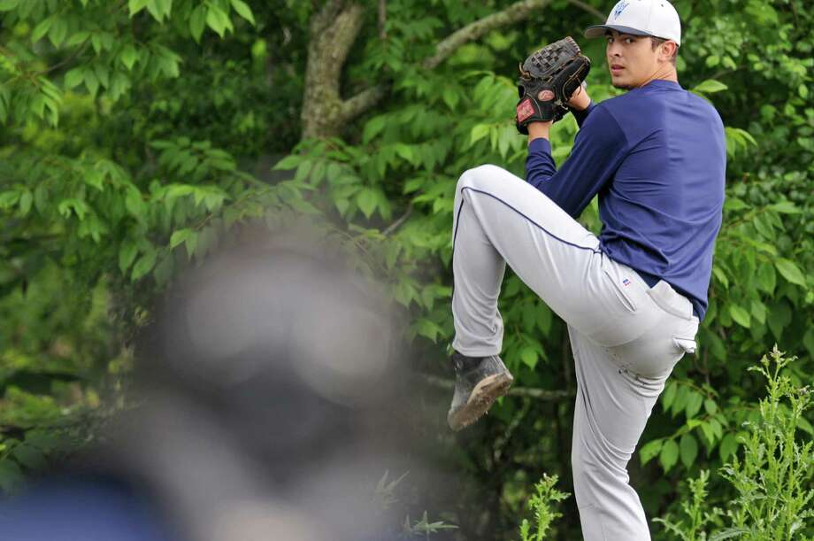 Columbia High School pitcher Connor Ramon throws a bullpen session as he and his teammates prepare for their state tournament game, on Monday June 4, 2012 in East Greenbush, NY.  (Philip Kamrass / Times Union ) Photo: Philip Kamrass / 00017937A